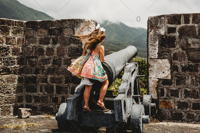Young girl plays in old fortress on a St Kitts Island Cruise Port Stop