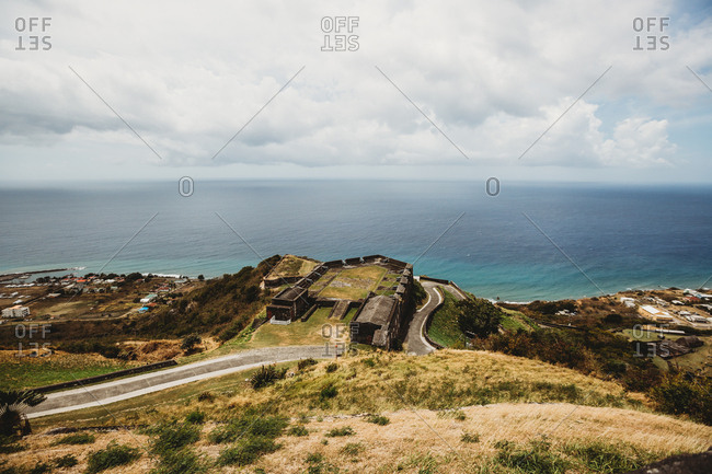 Lush landscape view of winding road and Atlantic Ocean on St Kitts