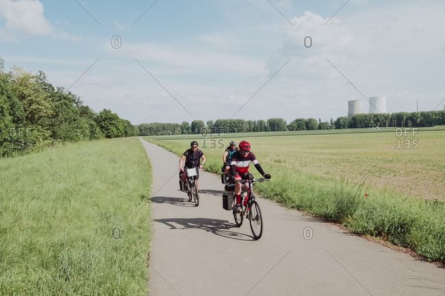 A group of cyclists riding his bikes in the Rin river route in Germany