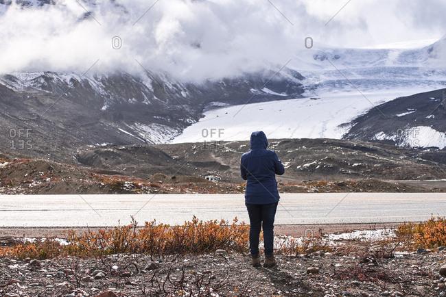 Woman watching Athabasca glacier, Jasper National Park