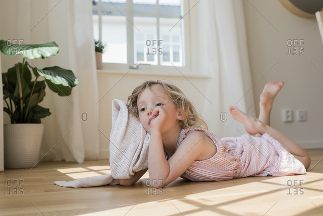 portrait of a girl laying down with her blanket at home