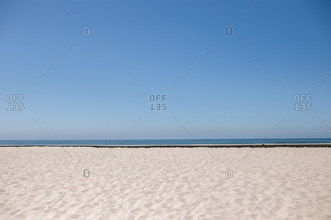 Minimalist landscape of sand, sea and sky in horizontal