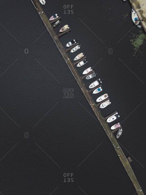 View of a long pier and boats from above