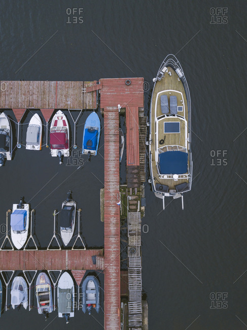 Pier and boats from above on the coast of Moscow, Russia