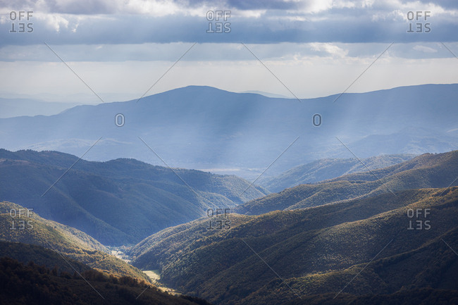 Weathered grass on the mountains hills meadows. Cloudy autumn day. Panoramic view of mountain landscape
