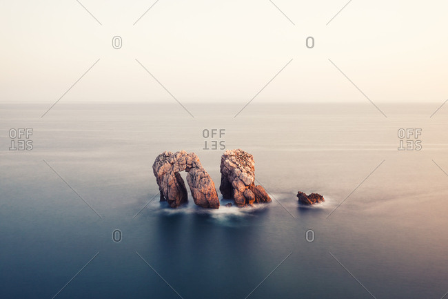 Rock formation at the ocean. Playa de la Arnia, Cantabria, Spain