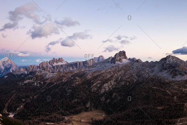 Sunset light over Alpine mountain landscape panorama