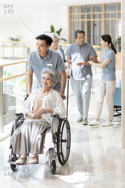 Chinese nursing assistant taking care of senior people
