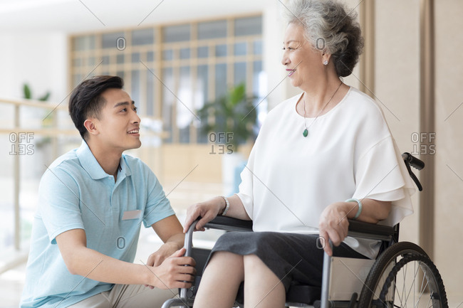 Chinese nursing assistant taking care of senior woman