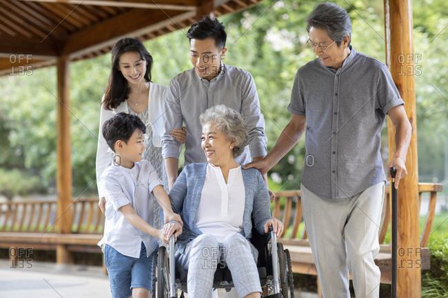 Happy Chinese family walking in corridor