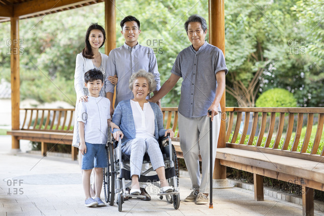 Happy Chinese family in pavilion