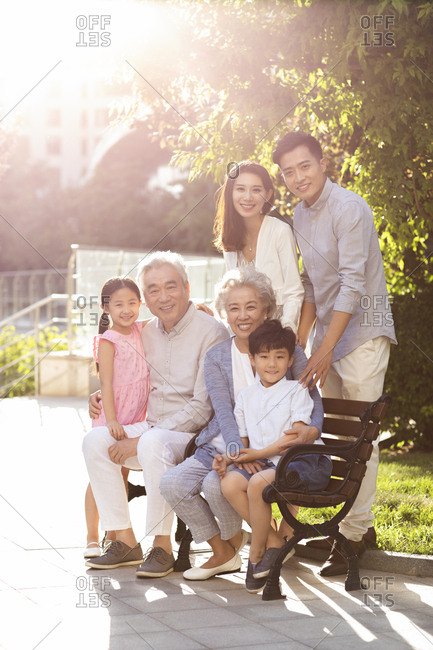 Happy Chinese family relaxing in nursing home