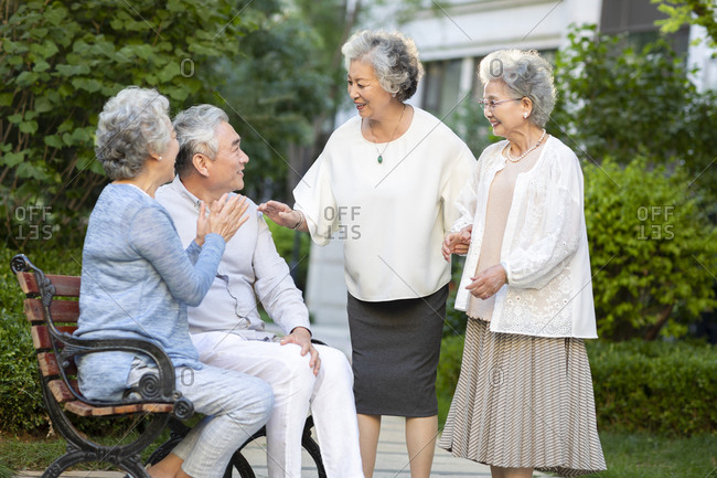 Senior Chinese friends talking in nursing home