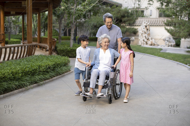 Happy Chinese family walking in yard