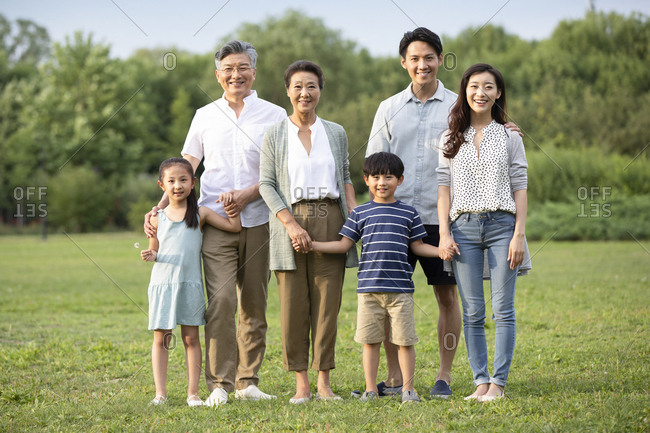 Happy Chinese family on grass