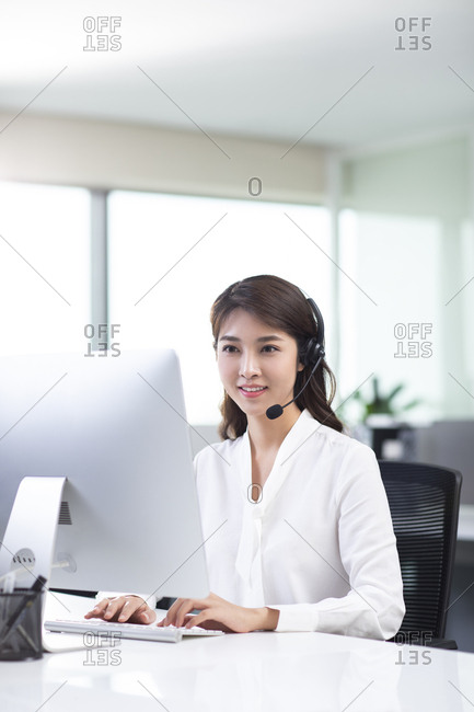 Young Chinese woman working in call center