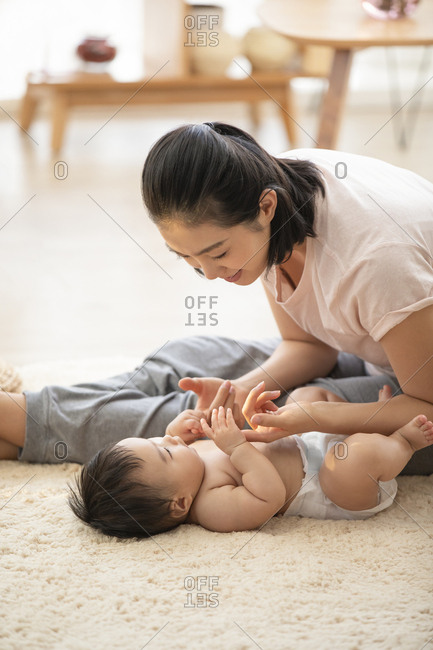 Young Chinese mom playing with her baby girl