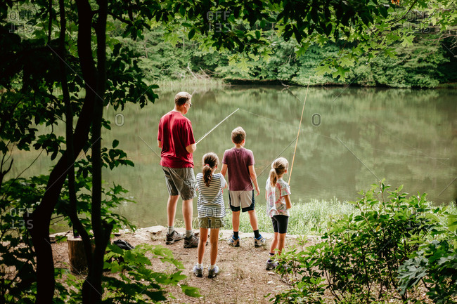 Family fishing in a lake together
