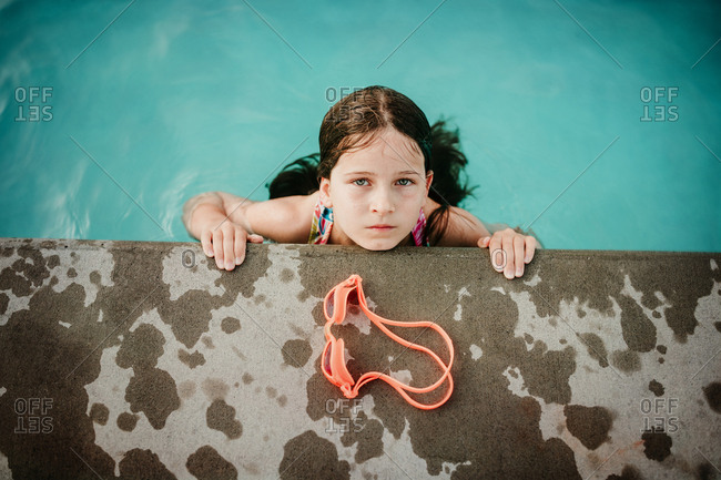 Girl looking up from the pool