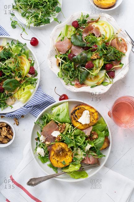 Raspberry prosciutto salad and grilled peaches mozzarella salad