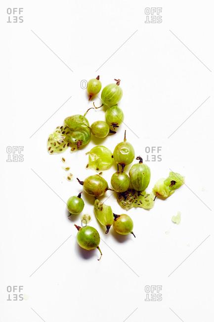 Overhead macro image of gooseberries whole and smashed