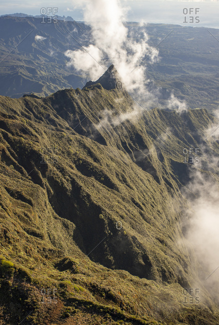 Puffy clouds amid Kauai mountains from helicopter