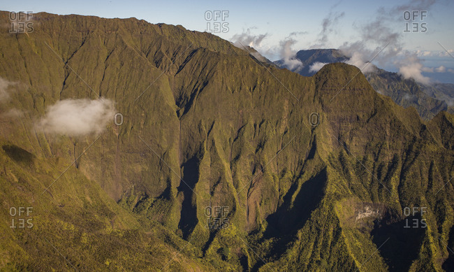 Clouds form around Kauai mountains as seen from helicopter