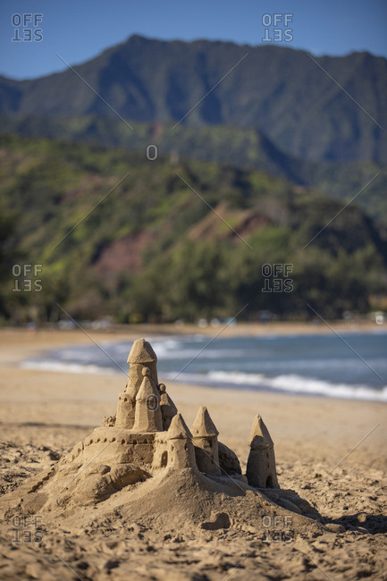 Sand castle on beach with mountain background, Hanalei bay, Kauai