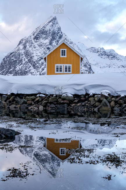 Fisherman hut (rorbu) and mount olstind, Sakrisoy, Norway