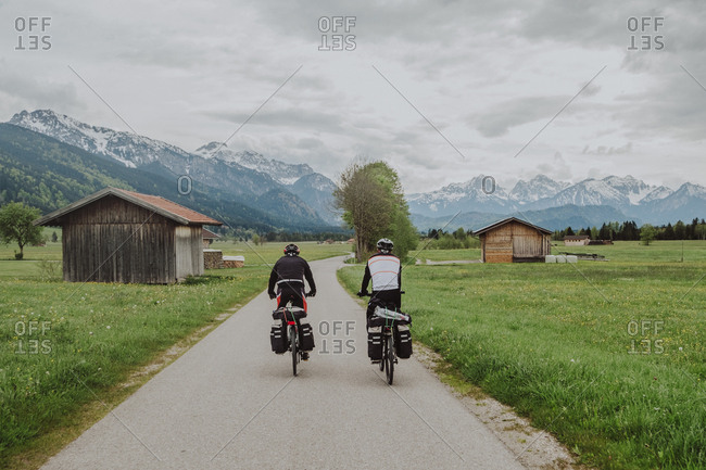 Cyclists ride his bikes in fussen, Germany