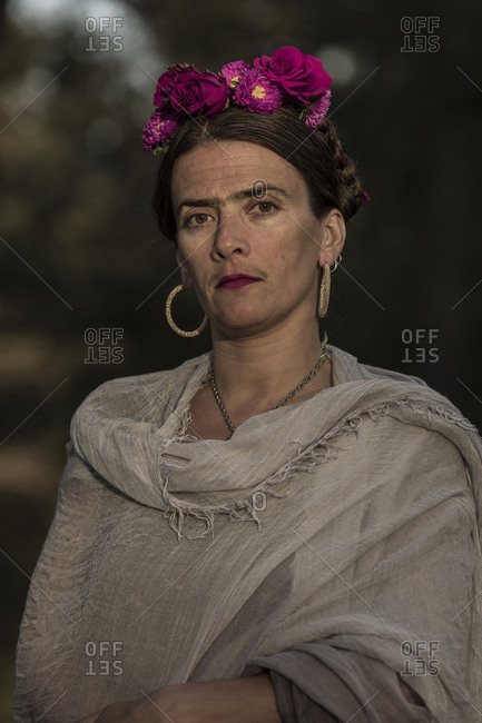 Close up portrait of a woman dressed up like the artist Frida Kahlo
