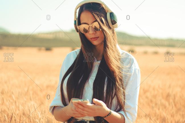 A millennial using different devises outdoor