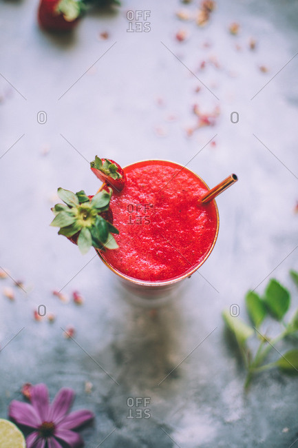 Strawberry margarita on soft grey background.