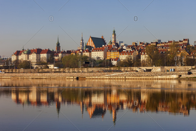 City skyline at sunrise- view across the Vistula River to the Old Town- Warsaw- Poland
