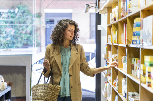 Young woman shopping in a food shop