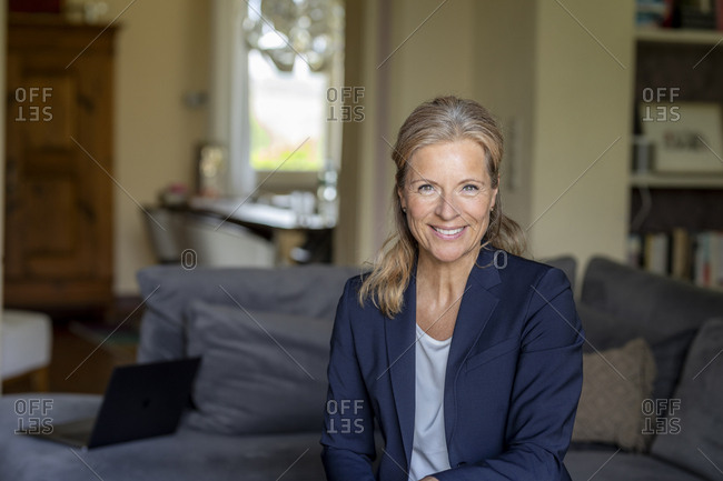 Portrait of smiling mature businesswoman at home