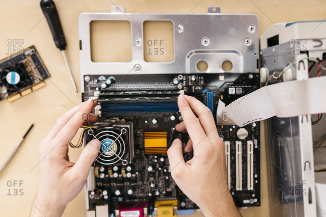 Close-up of technician repairing a desktop computer- changing the computer's RAM