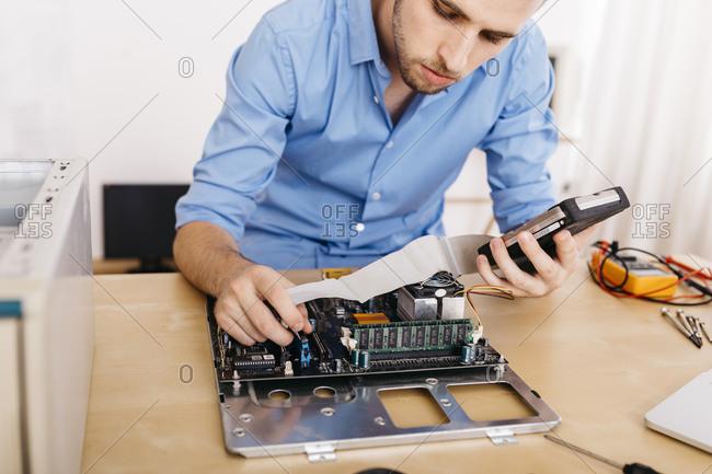 Technician repairing a desktop computer