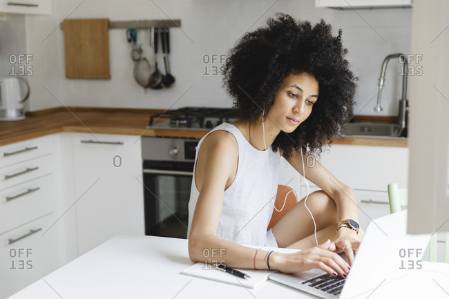 Young woman doing an online course on laptop