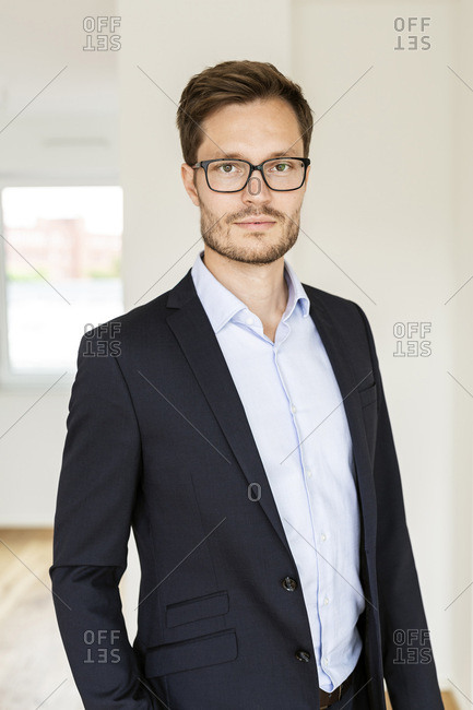 Portrait of a confident businessman in an apartment