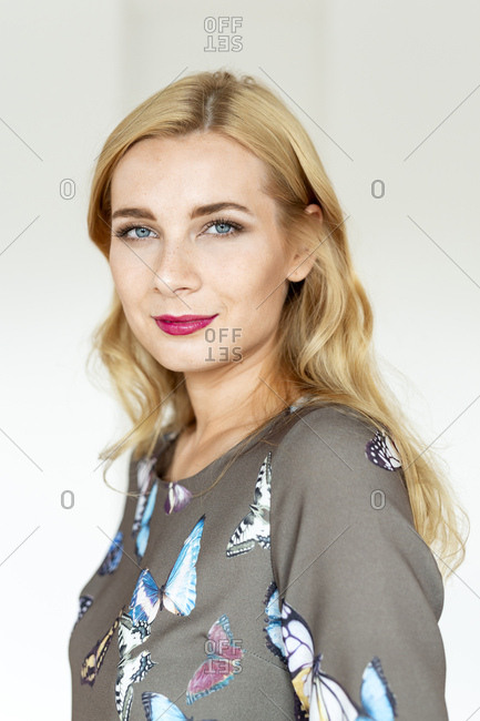 Portrait of a young woman wearing a dress with butterfly imprint