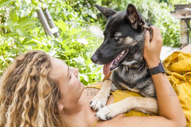 Husky shepherd mongrel dog and his mistress- face to face