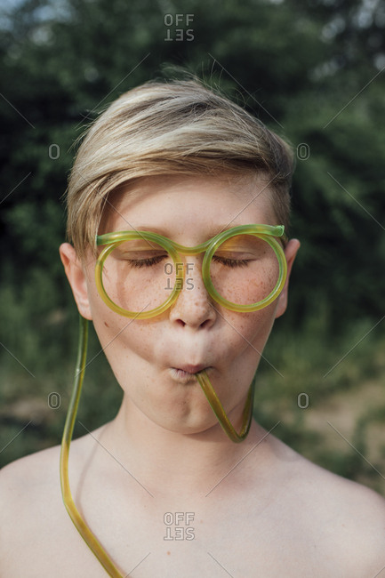 Portrait of freckled boy with funny glasses