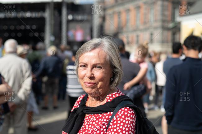 Portrait of a senior woman walking in urban area