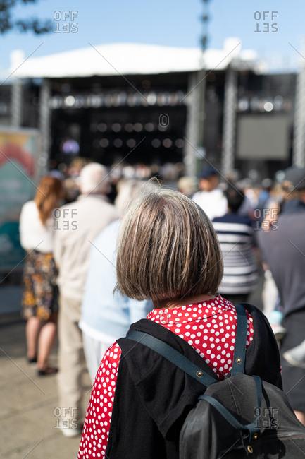 Rear view of a senior woman walking in urban area