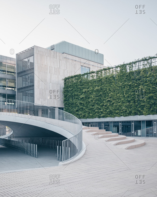 Copenhagen, Denmark - June 29, 2019: Curved railing over bike parking at the Karen Blixens Plads urban space at the University of Copenhagen