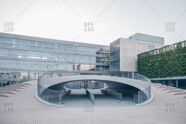 Copenhagen, Denmark - June 29, 2019: Curved railing over bicycle parking at the Karen Blixens Plads urban space at the University of Copenhagen
