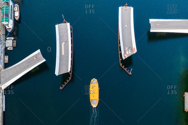Aerial view of yellow boat near the Lille Langebro bridge, Copenhagen, Denmark