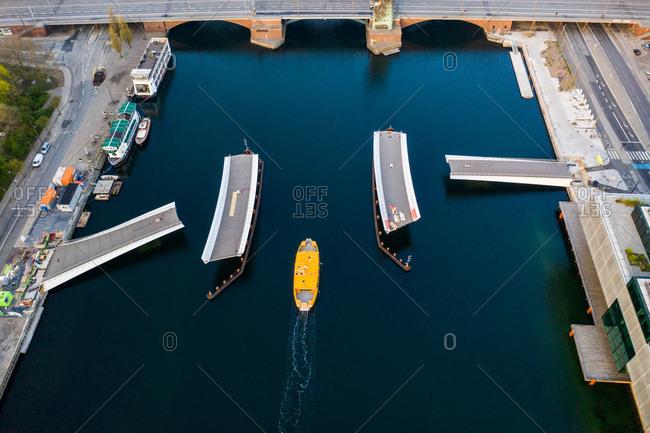 Copenhagen, Denmark - April 25, 2019: Aerial view of yellow boat near the Lille Langebro bridge