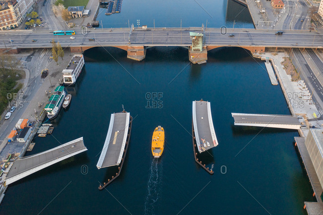 Copenhagen, Denmark - April 25, 2019: Overhead view of yellow boat near the Lille Langebro bridge